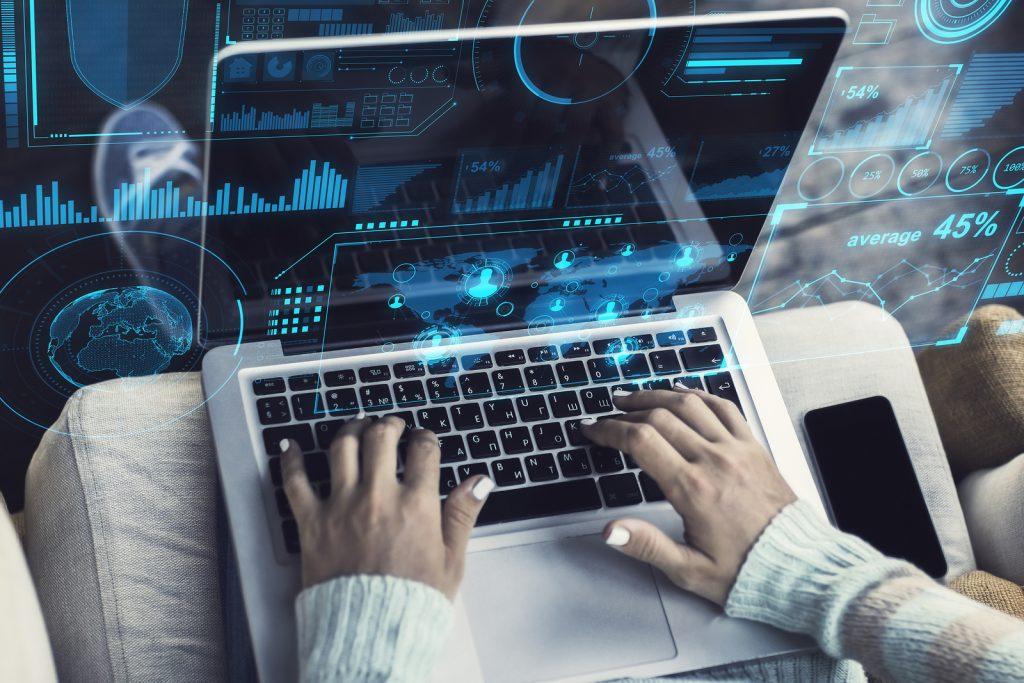 IT professional using laptop to multitask.